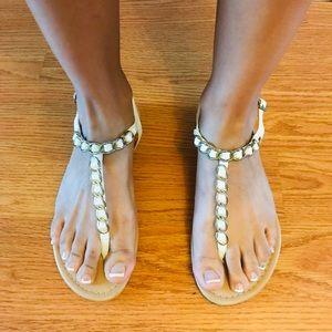 Report Flat Sandals